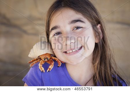 Young Pretty Girl Playing with Toy Hermit Crab.
