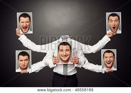 faceless man choosing mood. concept photo over dark background