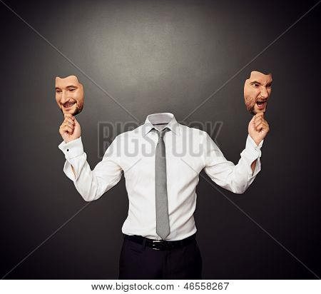 faceless man holding masks with good and bad moods