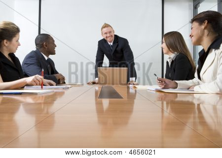 Co-workers In Business Meeting