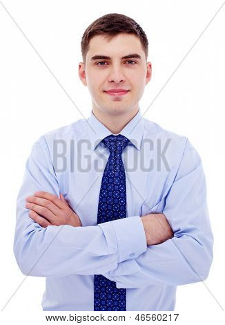 Young business man in blue shirt and tie standing with crossed arms. Isolated on white background, mask included