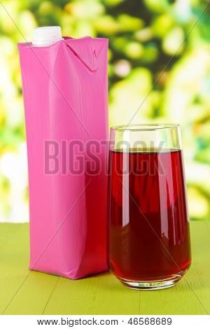 Juice pack on table on bright background