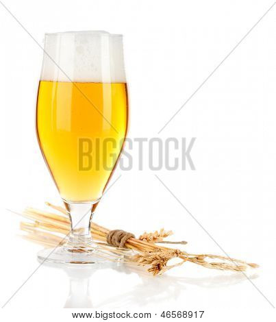 Glass of beer with spike lets on light yellow background