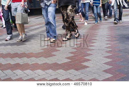 Multiple People Casually Dressed Walking In Crosswalk Downtown Street