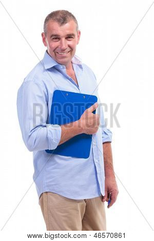 casual senior man holding a clipboard and smiling for the camera. isolated on white background