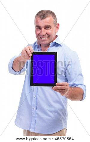 casual senior man showing you his tablet with a smile on his face. isolated on white background