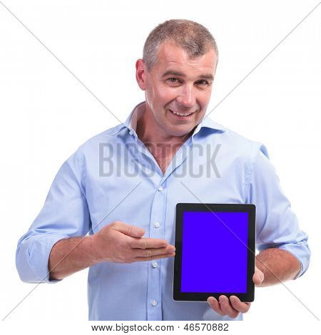 casual senior man presenting his tablet with a smile on his face. isolated on white background