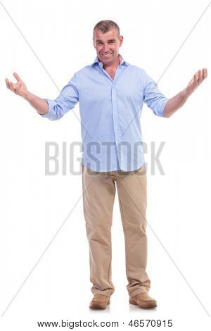 full length picture of a casual senior man welcoming you with a smile. isolated on white background