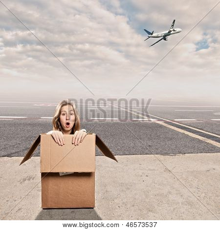 young woman inside a box at airport