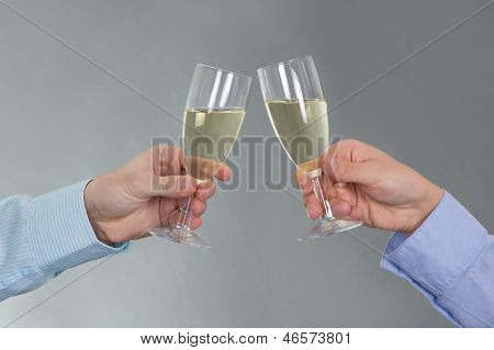 Male And Female Hands With Glass