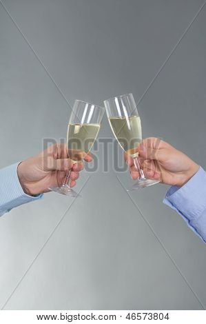Male And Female Hands With Glass Of Champagne