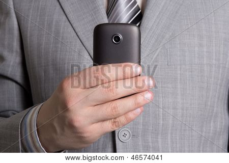 Businessman Hand With Mobile Phone