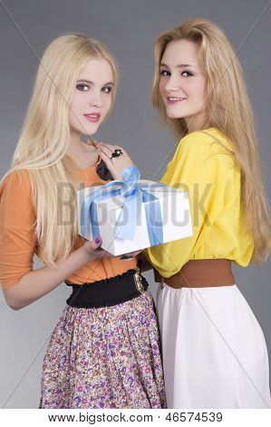 Portrait Of Two Young Women With A Gift Box