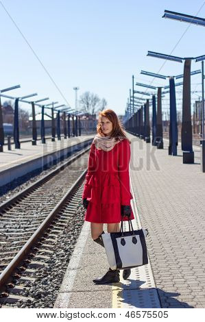 Young Woman With Bag At A Train Station