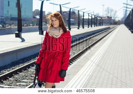 Woman Waiting A Train On The Station