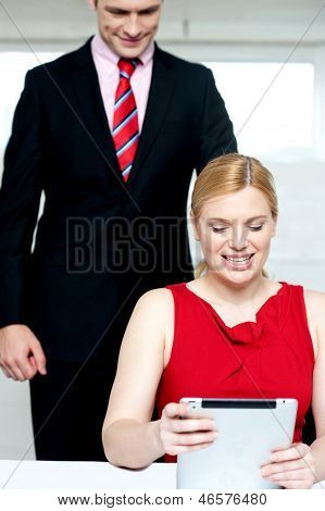Boss Operating Tablet Pc And Assistant Looking