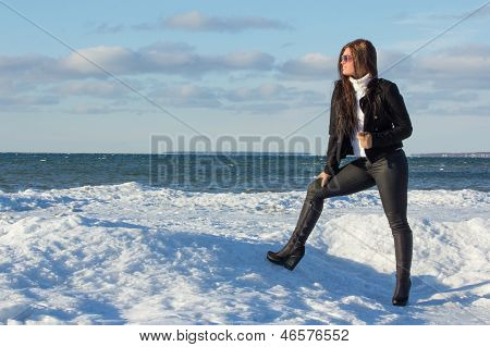 Portrait Of Young Brunette On Winter Beach
