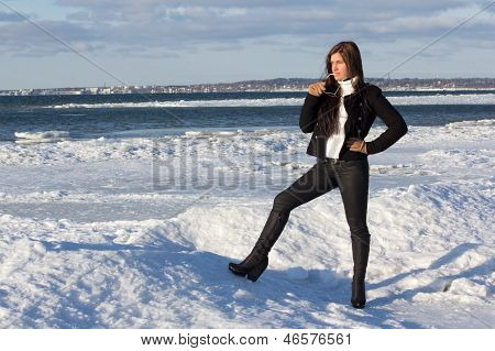 Portrait Of Young Woman On Winter Beach