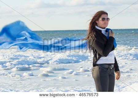 Portrait Of Young Woman With Scarf On Winter Beach