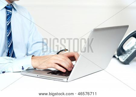 Closeup Shot Of Man Working On A Laptop