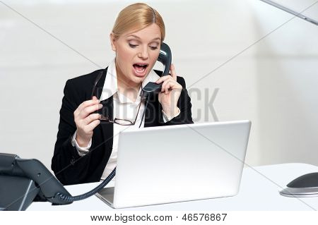 Woman Trying To Convince Client Over The Phone