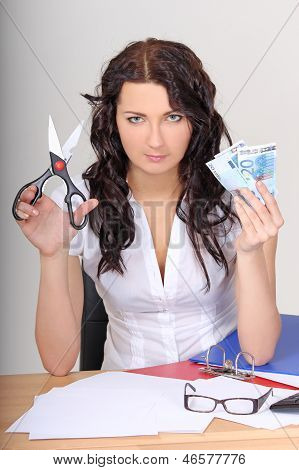 Business Woman With Euro And Scissors