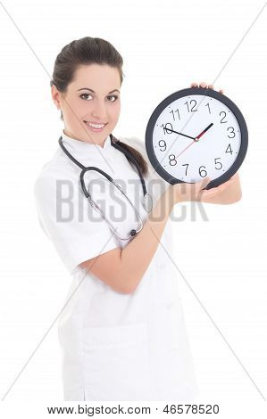 Young Beautiful Female Doctor With Clock Isolated On White