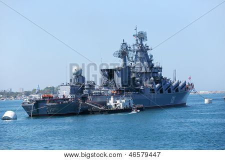 SEVASTOPOL, UKRAINE - MAY 7: Russian cruiser Moskva anchored in the bay of Sevastopol, Crimea, Ukraine on May 7, 2013. Ship prepares to the naval parade in honor of 230th anniversary of Black Sea Navy