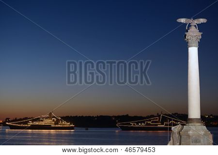 SEVASTOPOL, UKRAINE - MAY 8: Illuminated warships anchored in the bay of Sevastopol, Ukraine on May 8, 2013. Ships are prepared to naval parade in honor of the 230th anniversary of the Black Sea navy