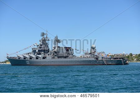 SEVASTOPOL, UKRAINE - MAY 8: Russian cruiser Moskva anchored in the bay before the military parade in honor of 230th anniversary of Black Sea Navy in Sevastopol, Crimea, Ukraine on May 8, 2013