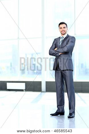 Full body portrait of young happy smiling cheerful business man