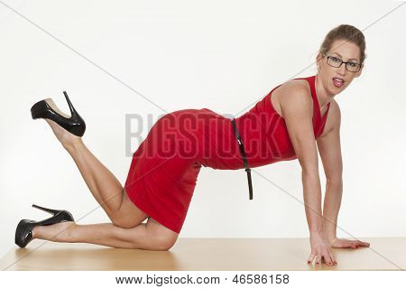 Provocative Blond Woman Wearing A Red Dress