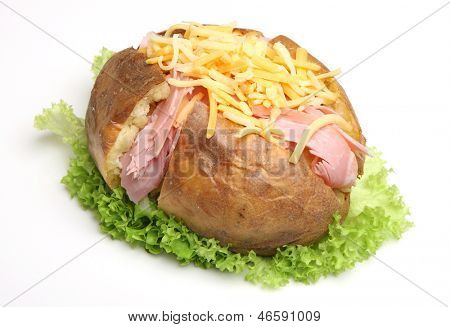Jacket potato filled with ham and grated cheese.
