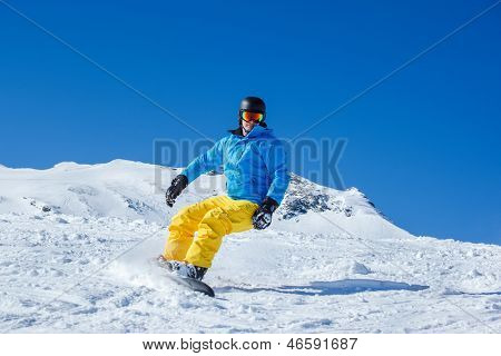 Active tourist on the snowboard