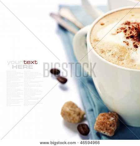 Close-up of white cup of coffee with blue napkin (with sample text)