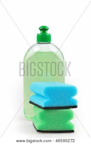 Detergent. Green Dishwashing Liquid And Sponges.