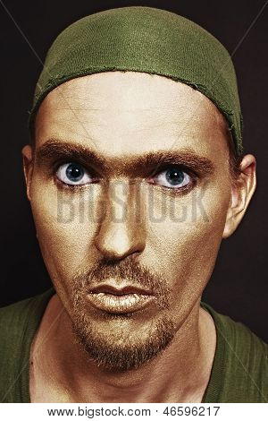 Blue-eyed Men With Gold Makeup In Green Headscarf