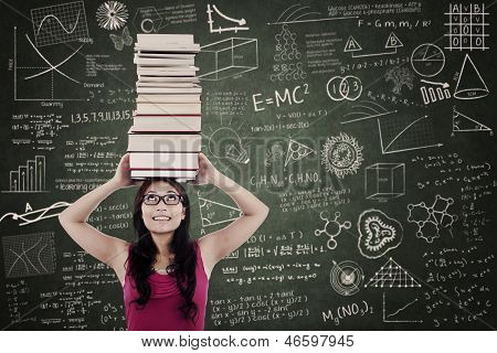 Attractive Female Bring Books On Her Head At Class