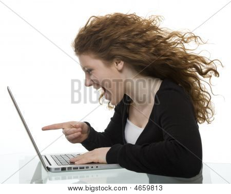 Red Haired Teenager With Laptop