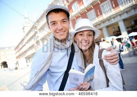 Couple standing in la Plaza Mayor de Madrid
