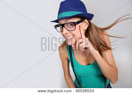 Stylish girl with suspenders showing big smile
