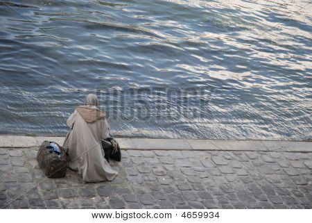 Old Woman Along The Seine