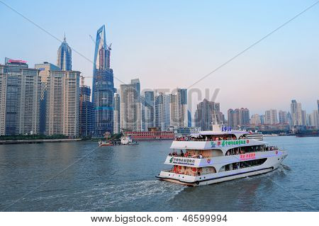SHANGHAI, CHINA - JUNE 2: Urban architectures with boat on June 2, 2012 in Shanghai, China. Shanghai is the largest city by population in the world with 23 million as in 2010.