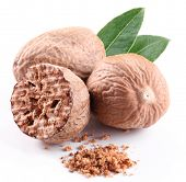 stock photo of ground nut  - Nutmeg with leaves on a white background - JPG