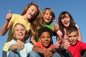 picture of happy kids  - group of diverse kids or children with thumbs up - JPG