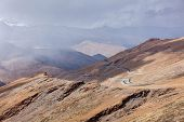 image of manali-leh road  - Road in Himalayas in clouds near Tanglang la Pass   - JPG