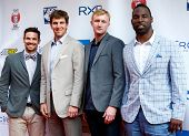 NEW YORK-MAY 30: (L to R) Heath Pearce, Eli Manning, Ryan Meara, and Justin Tuck attend the 5th annu