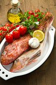 stock photo of redfish  - Redfish with tomatoes parsley garlic and olve oil - JPG