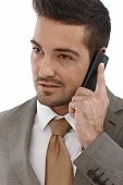 Closeup portrait of young businessman on mobile phone.