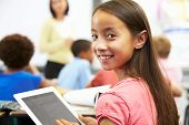 foto of 11 year old  - Pupil In Class Using Digital Tablet - JPG